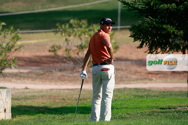 Rafael Cabrera-Bello (ESP) waits for a ruling after landing his ball up against a wall on the 2nd hole during Thursday's Round 1 of the Castello Masters at the Club de Campo del Mediterraneo, Castellon, Spain, 20th October 2011 (Photo Eoin Clarke/www.golffile.ie)