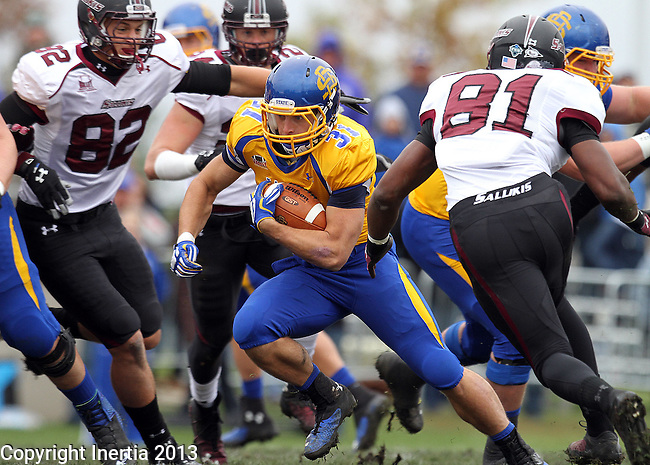 BROOKINGS, SD - OCTOBER 5:  Zach Zenner #31 from South Dakota State University looks for running room between Brandon Williams #82 and Leonard Garron #81 from Southern Illinois in the first quarter Saturday afternoon at Coughlin Alumni Stadium in Brookings. (Photo by Dave Eggen/Inertia)