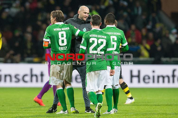 20.12.2014, Weser Stadion, Bremen, GER, 1.FBL, Werder Bremen vs Borussia Dortmund, im Bild<br /> <br /> <br /> Grenzenloser Jubel nach dem Abpfiff und Sieg <br /> Clemens Fritz (Bremen #8)<br /> Christian Vander (Torwart-Trainer Werder Bremen)<br /> Fin Bartels (Bremen #22)<br /> Zlatko Junuzovic (Bremen #16)<br /> <br /> <br /> <br /> Foto &copy; nordphoto / Kokenge