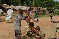 Town Whips and Wales on Each Other..The whipping is more severe on the last day and includes a ceremony where the boys are secluded within a phalanx of men all carrying whips... the men are met halfway thru the village with women carrying whips and a melee ensues trying to control the destiny of the child... the men win... the boy is now a man and cannot be claimed as a child anymore by his mother.  There is also ritual scarification on this day and each boy is paraded, one by one thru the village accompanied by a masked elder and someone to collect the money being thrown at his dancing feet.....