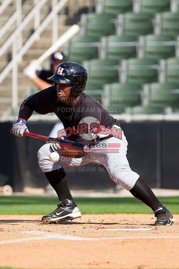 Odubel Herrera #2 of the Hickory Crawdads drops down a bunt against the Kannapolis Intimidators at Fieldcrest Cannon Stadium on April 17, 2011 in Kannapolis, North Carolina.   Photo by Brian Westerholt / Four Seam Images