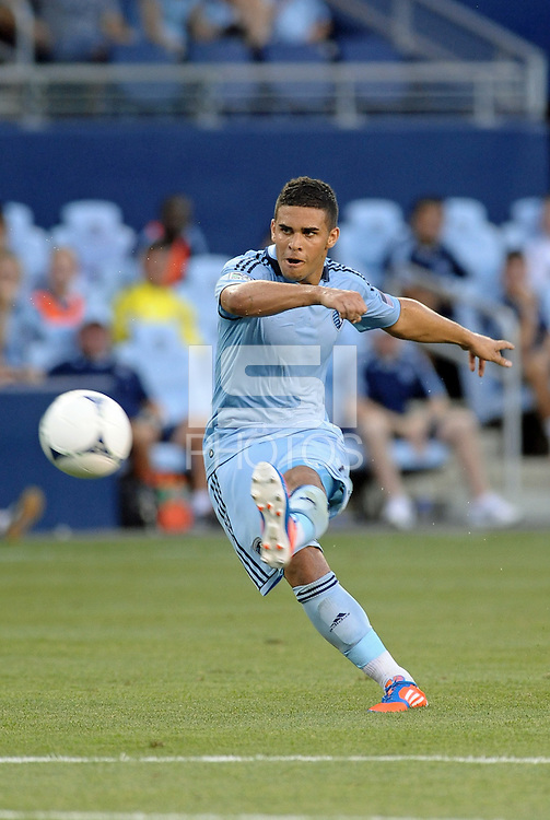Dom Dwyer (14) forward Sporting KC takes a free kick..Sporting Kansas City were defeated 3-0 by Montpellier HSC in an international friendly at LIVESTRONG Sporting Park, Kansas City, KS..