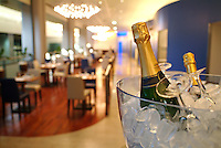Champagne cooling on ice in a restaurant, France.