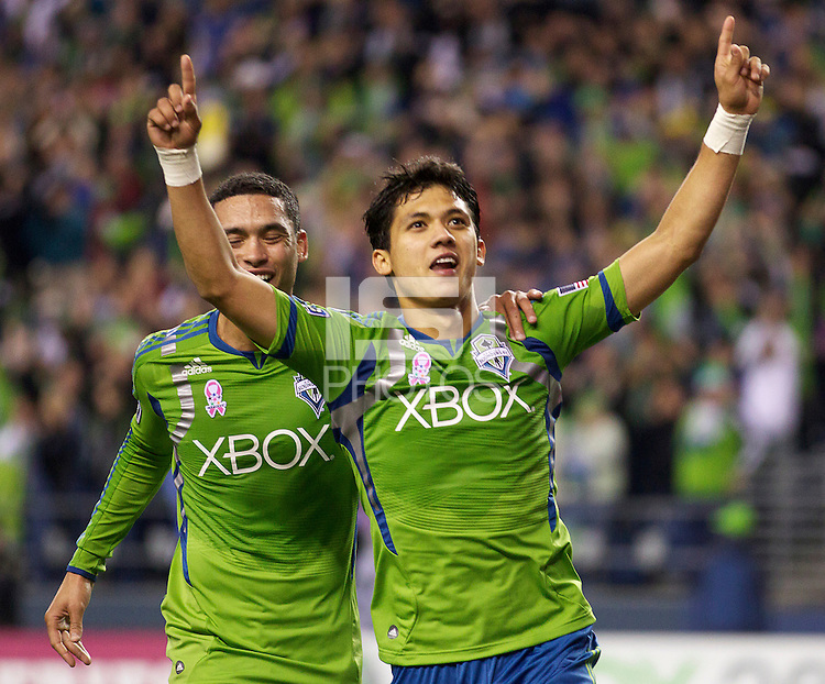 Seattle Sounders FC forward Fredy Montero, right, and forward Lamar Neagle celebrate Montero's game-winning goal during play against the San Jose Earthquakes at CenturyLink Field in Seattle Saturday October 15, 2011. The Sounders FC won the game 2-1.