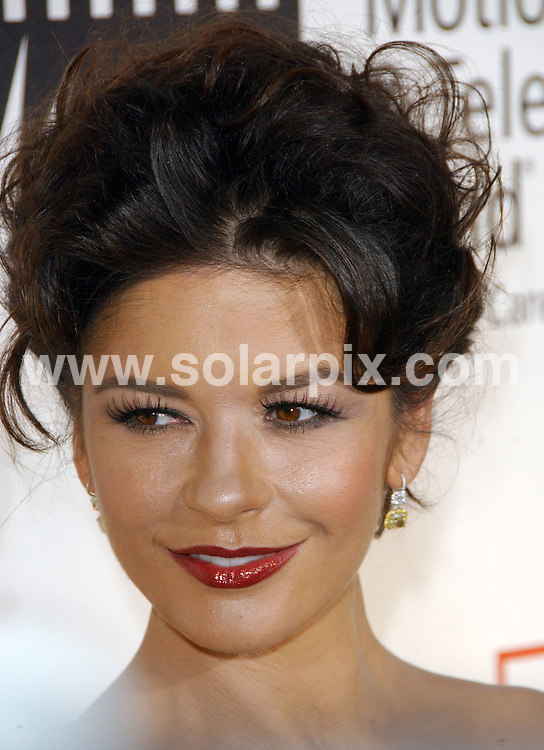"**ALL ROUND PICTURES FROM SOLARPIX.COM**.**SYNDICATION RIGHTS FOR UK, SPAIN, PORTUGAL, AUSTRALIA, S.AFRICA & DUBAI (U.A.E) ONLY**.Catherine Zeta Jones arrives at the 4th Annual ""A Fine Romance"" to Benefit The Motion Picture & Television Fund. Held at the Sony Studios/Stage 30, Culver City, California, USA. 8th November 2008..This pic: Catherine Zeta Jones..JOB REF: 7825 PHZ (Ortega)   DATE: 09_11_2008 .**MUST CREDIT SOLARPIX.COM OR DOUBLE FEE WILL BE CHARGED* *UNDER NO CIRCUMSTANCES IS THIS IMAGE TO BE REPRODUCED FOR ANY ONLINE EDITION WITHOUT PRIOR PERMISSION*"