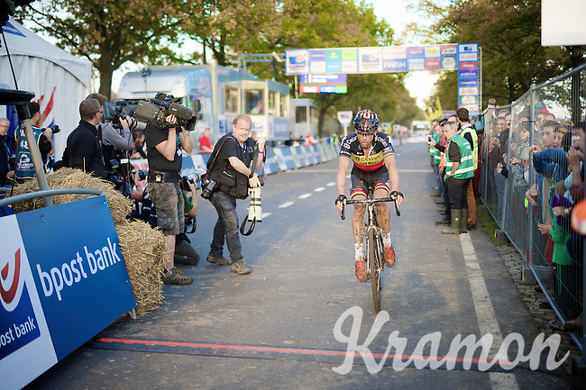 A disappointed Sven Nys (BEL/Crelan-AAdrinks) crosses the finish line.<br /> He was (intentionally) hindered in the finish straight by a teammate (who was 1 lap behind) from eventual winner Wout Van Aert (BEL/Vastgoedservice-Golden Palace).<br /> <br /> Koppenbergcross 2014