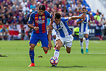 FC Barcelona's Luis Suarez and Club Deportivo Leganes's Unai Bustinza during the match of La Liga between Club Deportivo Leganes and Futbol Club Barcelona at Butarque Estadium in Leganes. September 17, 2016. (ALTERPHOTOS/Rodrigo Jimenez)