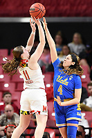 College Park, MD - March 25, 2019: Maryland Terrapins guard Taylor Mikesell (11) barely gets her shot off over UCLA Bruins guard Lindsey Corsaro (4) during second round game of NCAAW Tournament between UCLA and Maryland at Xfinity Center in College Park, MD. UCLA advanced to the Sweet 16 defeating Maryland 85-80.(Photo by Phil Peters/Media Images International)