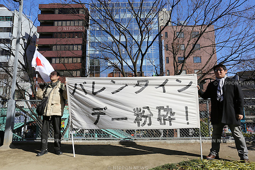 "Demonstrators holds a banner reading ""Smash Valentine's Day"" before they march through the streets of Shibuya district in Tokyo, Japan on February 14, 2015. The group called Kakuhidou, meaning  ""Revolutionary alliance of men whom women find unattractive"" protested that Valentine's Day  is only about marketing and making money by chocolate companies.  (Photo by Yuriko Nakao/AFLO)"