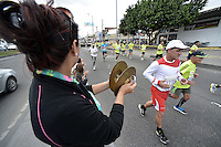 BOGOTÁ -COLOMBIA. 27-07-2014. Aspecto de los participantes en la Media Maratón de Bogotá 2014. En esta ocasión Geoffrey Kipsang (Kenia) fue el ganador con un tiempo de 1.03:18 y en mujeres Rita Jeptoo (Kenia)con un tiempo de 1.13:36. / Aspect of the people during the Half Marathon of Bogota 2014. In this edition the winner was Geoffrey Kipsang (Kenya) with a time of 1.03:18 and in women the winner  was Rita Jeptoo (Kenya) with a time of 1.13:36. Photo: VizzorImage/ Gabriel Aponte / Staff