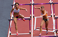 03 AUG 2012 - LONDON, GBR - Katarina Johnson-Thompson (GBR) (left) of Great Britain clears a hurdle as Dafne Schippers (NED) of the Netherlands stumbles during her heat in the women's heptathlon at the London 2012 Olympic Games athletics in the Olympic Stadium in the Olympic Park in Stratford, London, Great Britain .(PHOTO (C) 2012 NIGEL FARROW)