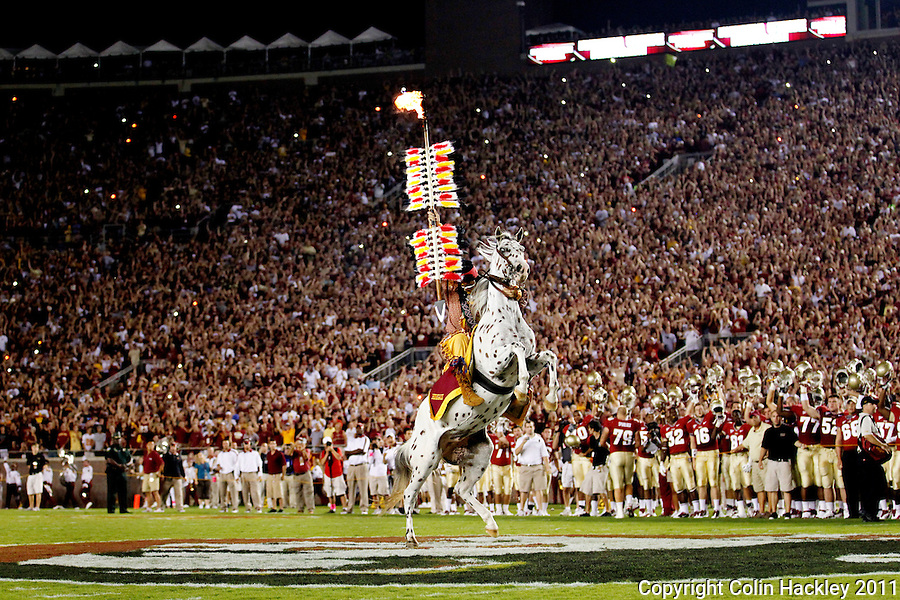 TALLAHASSEE, FL 9/17/11-FSU-OU091711 CH-Florida State University Mascot Osceola plants the spear at midfield prior to the Oklahoma Saturday at Doak Campbell Stadium in Tallahassee. .COLIN HACKLEY PHOTO