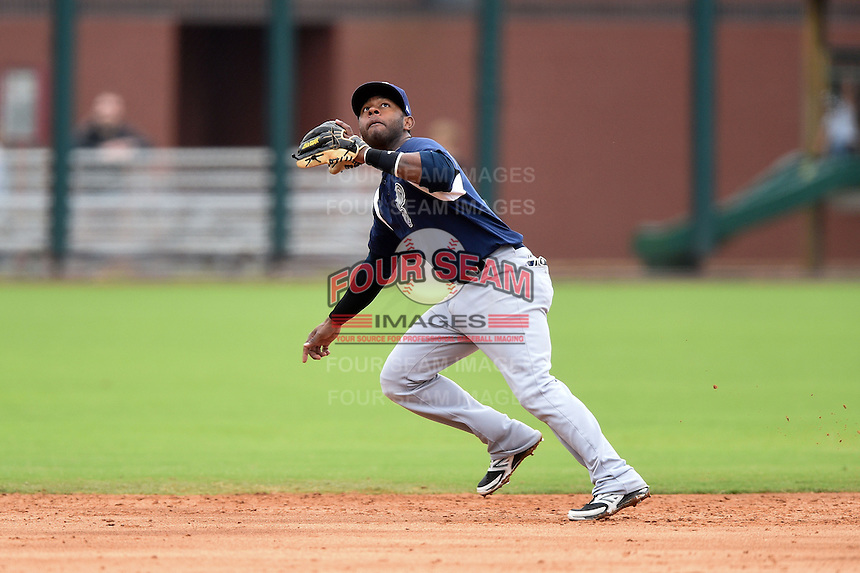 Pensacola Blue Wahoos shortstop Rey Navarro (1) tracks an infield pop up during a game against the Jacksonville Suns on April 20, 2014 at Bragan Field in Jacksonville, Florida.  Jacksonville defeated Pensacola 5-4.  (Mike Janes/Four Seam Images)