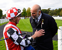 Jockey Andrea Atzeni chats to a connection of Jamil in the winners enclosure after winning The Become a Wiltshire Freemason EBF Novice Stakes    during Afternoon Racing at Salisbury Racecourse on 4th October 2017