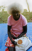 Aboriginal woman weaving, Tiwi Island
