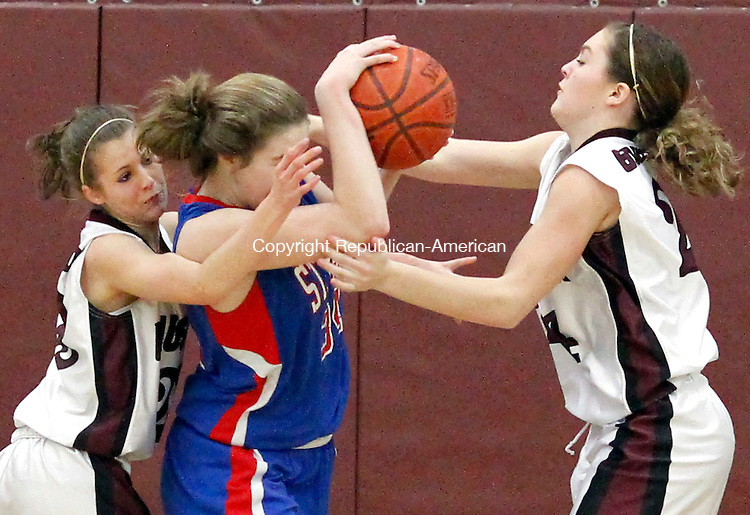 Naugatuck, CT-24 January 2012-012412CM09-  Naugatuck's Emma Colucci (left) and Amber Kuczenski swarm St. Paul's Theresa Swanke during their NVL matchup in Naugatuck Tuesday night. Colucci was called for the foul on the play as Naugy went on to win, 51-38.   Christopher Massa Republican-American