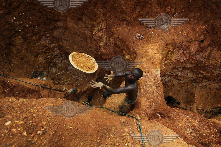 A young man works on a gold mining site in Obuasi. Many unemployed young people have taken to working as illegal artisanal gold miners known as galamseys in Ghana.