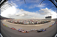 Nov. 8, 2009; Fort Worth, TX, USA; NASCAR Sprint Cup Series drivers race through turn one during the Dickies 500 at the Texas Motor Speedway. Mandatory Credit: Mark J. Rebilas-