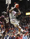 "Mississippi's Murphy Holloway (31) is fouled by Mississippi State's Gavin Ware (20) at the C.M. ""Tad"" Smith Coliseum on Wednesday, February 6, 2013. (AP Photo/Oxford Eagle, Bruce Newman).."