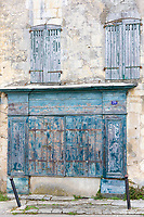 Typical building with weatherworn shutters and paintwork, traditional architecture, St Martin de Re, Ile de Re, France