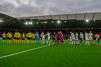Players from Swansea and Millwall shake hands during the Sky Bet Championship match between Swansea City and Millwall at the Liberty Stadium in Swansea, Wales, UK. Saturday 23rd November 2019