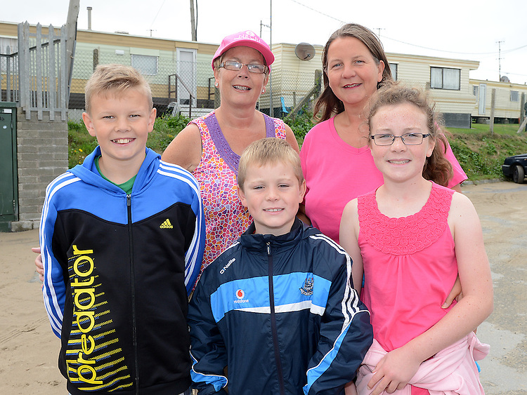 Jackie and Ron Corry and  Edel, Daniel and Aoife Kenny who took part in the pink strollers annual walk on Clogherhead beach. Photo:Colin Bell/pressphotos.ie