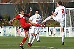 15 November 2009: NC State's Farouk Bseiso (5) and Virginia's Jordan Evans (2) challenge for the ball in front of Jonathan Villanueva (10). The University of Virginia Cavaliers defeated the North Carolina State University Wolfpack at WakeMed Stadium in Cary, North Carolina in the Atlantic Coast Conference Men's Soccer Tournament Championship game.