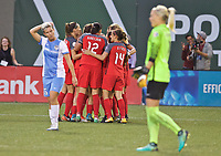 Portland, OR - Saturday August 19, 2017: Thorns celebrate a goal, Amandine Henry  during a regular season National Women's Soccer League (NWSL) match between the Portland Thorns FC and the Houston Dash at Providence Park.