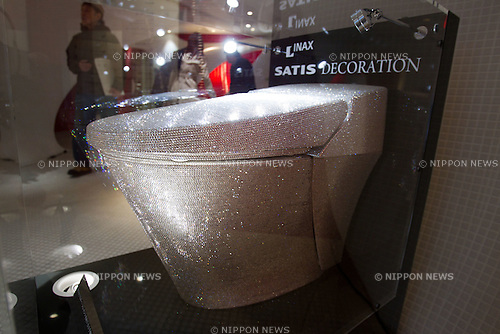 "Dec 14, 2011, Tokyo, Japan - Housing and building material manufacturer Lixil Corp. showcases the company's Inax brand toilet ""Statis"" covered in 72,000 Swarovski crystals valued approximately at $128,000 USD. Lixil showroom manager Kazuo Sumimiya said he hopes this heavily decorated one of a kind toilet will draw more tourists to Japan. The toilet will remain on display at Lixil's company showroom in Tokyo until December 28. (Photo by Christopher Jue/AFLO)"