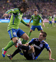 Seattle Sounders FC midfielder Mauro Rosales, left, and San Jose Earthquakes defender Sam Cronin tangle during play at CenturyLink Field in Seattle Saturday October 15, 2011. The Sounders FC won the game 2-1.