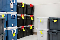 Coolers and supply kits used in the organ donation process stand in a supply room at the New England Organ Bank, an organ procurement organization based in Waltham, Massachusetts, serving the greater New England area.
