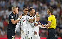 Kyle Walker of Tottenham Hotspur indicates a card to Referee Gianluca Rocchi (Italy) while an angry looking Kamil Glik of Monaco stands behind during the UEFA Champions League Group stage match between Tottenham Hotspur and Monaco at White Hart Lane, London, England on 14 September 2016. Photo by Andy Rowland.