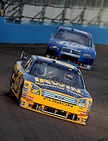 Nov. 9, 2008; Avondale, AZ, USA; NASCAR Sprint Cup Series driver Jamie McMurray leads Kurt Busch during the Checker Auto Parts 500 at Phoenix International Raceway. Mandatory Credit: Mark J. Rebilas-