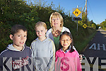 Patrick O'Connor, Jasmin Grey and Anna O'Connor students at Ballyfinane School with principal Eileen Daly pictures at the traffic warning lights which have been broken for some time.