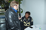 A'Lique Terry (55) of the Wake Forest Demon Deacons answers questions during Media Day for the 2017 Belk Bowl at the Charlotte Convention Center on December 28, 2017 in Charlotte, North Carolina.  (Brian Westerholt/Sports On Film)