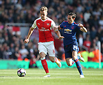 Arsenal's Rob Holding tussles with Manchester United's Matteo Darmian during the Premier League match at the Emirates Stadium, London. Picture date: May 7th, 2017. Pic credit should read: David Klein/Sportimage