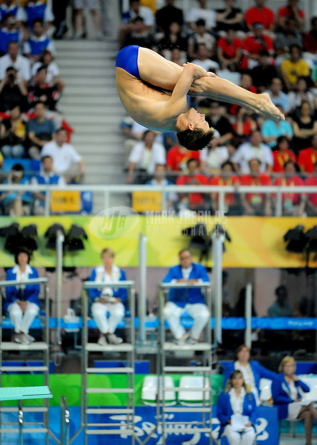 Aug. 19, 2008; Beijing, CHINA; Chris Colwill (USA) competes in the mens 3m springboard final at the National Aquatics Center during the 2008 Beijing Olympics. Mandatory Credit: Mark J. Rebilas-