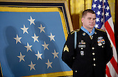 Kyle J. White, a former active duty U.S. Army Sergeant, listens as United States President Barack Obama awards him the Medal of Honor for conspicuous gallantry in the East Room of the White House, May 13, 2014 in Washington, DC. <br /> Credit: Olivier Douliery / Pool via CNP