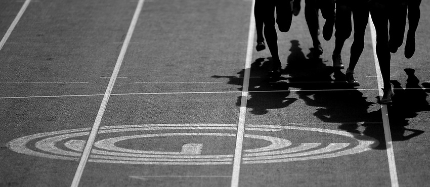 Competitors in the men's 1500m round 1 - head 1 run past the Glasgow 2014 Commonwealth Games logo printed on the race track<br /> <br /> Photographer Chris Vaughan/CameraSport<br /> <br /> 20th Commonwealth Games - Day 9 - Friday 1st August 2014 - Athletics - Hampden Park - Glasgow - UK<br /> <br /> © CameraSport - 43 Linden Ave. Countesthorpe. Leicester. England. LE8 5PG - Tel: +44 (0) 116 277 4147 - admin@camerasport.com - www.camerasport.com