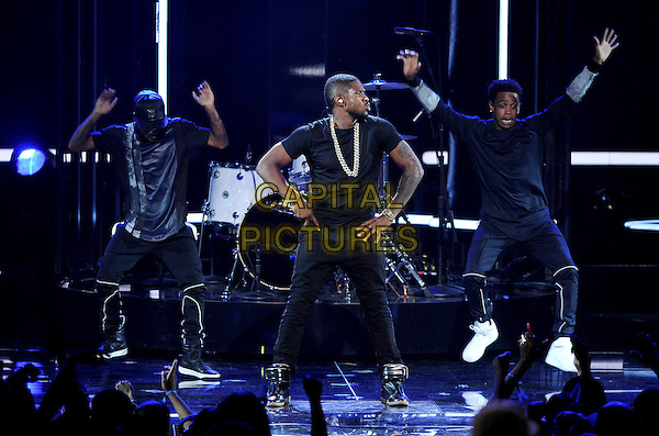 LOS ANGELES, CA - JUNE 29 : Usher performs onstage at the BET Awards '14 at Nokia Theatre L.A. Live on June 29, 2014 in Los Angeles, California. <br /> CAP/MPI/PGMIC<br /> &copy;PGMIC/MPI/Capital Pictures