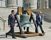 United States President Donald J. Trump and US Secretary of the Treasury Steven Mnuchin walk past a replica of the Liberty Bell as they go back to the White House after the President signed Executive Orders concerning financial services at the Department of the Treasury in Washington, DC on April 21, 2017.<br /> Credit: Ron Sachs / Pool via CNP