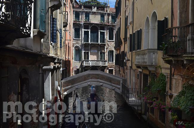Michael McCollum.6/10/11.Gondolas navigate the smaller canals in Venice, Italy.