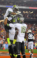 Jan 10, 2011; Glendale, AZ, USA; Oregon Ducks running back LaMichael James (21) celebrates with teammates after scoring a touchdown during the first half of the 2011 BCS National Championship game against the Auburn Tigers at University of Phoenix Stadium.  Mandatory Credit: Mark J. Rebilas-