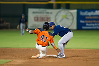 AZL Brewers Julio Mendez (3) tags Nathanael Javier (47) on a stolen base attempt during a game against the AZL Giants on August 15, 2017 at Scottsdale Stadium in Scottsdale, Arizona. AZL Giants defeated the AZL Brewers 4-3. (Zachary Lucy/Four Seam Images)