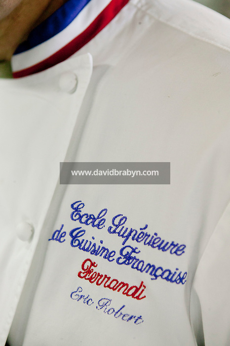 "View of embrodery on chef Eric Robert coat at the Ecole Superieure de Cuisine Francaise Gregoire Ferrandi cooking school in Paris, France, 18 December 2007. The red, whit and blue collar indicates that he has been recognized as a ""Meilleur Ouvrier de France""."