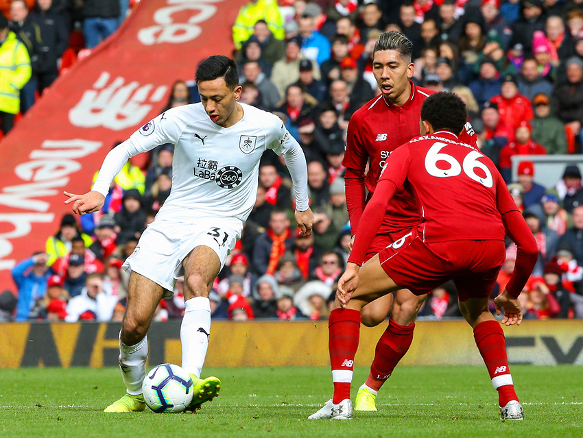 Burnley's Dwight McNeil takes onLiverpool's Trent Alexander-Arnold and Roberto Firmino<br /> <br /> Photographer Alex Dodd/CameraSport<br /> <br /> The Premier League - Liverpool v Burnley - Sunday 10th March 2019 - Anfield - Liverpool<br /> <br /> World Copyright © 2019 CameraSport. All rights reserved. 43 Linden Ave. Countesthorpe. Leicester. England. LE8 5PG - Tel: +44 (0) 116 277 4147 - admin@camerasport.com - www.camerasport.com