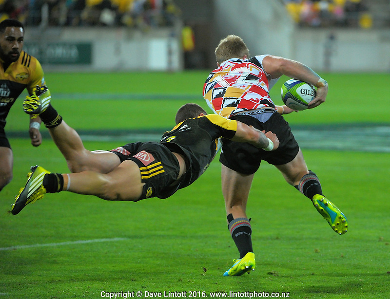 TJ Perenara tries to stop Shane Gates during the Super Rugby match between the Hurricanes and Southern Kings at Westpac Stadium, Wellington, New Zealand on Friday, 25 March 2016. Photo: Dave Lintott / lintottphoto.co.nz
