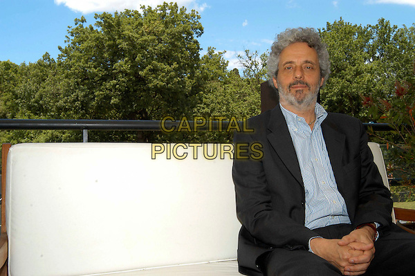 "NICOLA PIOVANI .Photocall for ""Fauteuils D'Orchestre"", Casa Del Cinema, Rome, Italy..June 7th, 2006.Ref: CAV.half length grey gray jacket sitting.www.capitalpictures.com.sales@capitalpictures.com.© Capital Pictures."