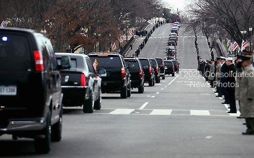 United States President Barack Obama's motorcade travels from the White House to the U.S. Capitol along Constitution Avenue January 21, 2013 in Washington, DC. Obama and U.S. Vice President Joe Biden will begin their second term in office by taking the Oath of Office later in the morning during a ceremony on the West Front of the U.S. Capitol.  .Credit: Chip Somodevilla / Pool via CNP