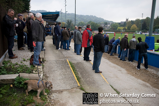 Matlock Town 0 Eastwood Town 3, 09/10/2010. Causeway Lane, FA Cup 3rd qualifying round. Spectators and a dog watching the action during the FA Cup 3rd qualifying round tie between Matlock Town and Eastwood Town at Causeway Lane, Matlock. The visitors from Nottingham who play one division higher than Matlock won by three goals to nil to move to within one round of the FA Cup 1st round proper. The match was watched by 655 spectators. Photo by Colin McPherson.